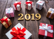 New year 2019 and gift box on wood table