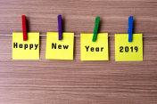 Happy New Year 2019 on notes hanging by clothespins
