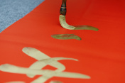 Chinese traditional custom: writing Spring Festival couplets.
