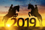 Riders on the horse jumping into the New Year 2019