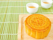 Mooncake on a wooden plate for Mid-Autumn Festival