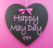 Happy May Day handwriting greeting on heart shaped blackboard