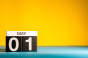 May 1st. Day 1 of may month, calendar on yellow background. Spring time, International labor day