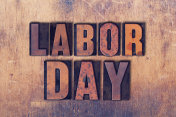 Labor Day Theme Letterpress Word on Wood Background