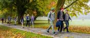University students walking on footpath