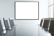 Blank white picture frame on the wall of conference room