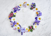 summer flower wreath on a marble table