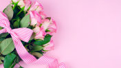 Mother's Day background of pink roses with copy space on pink wood table