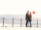 Young couple in love at the riverside