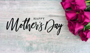 Happy Mother's Day Text with Bright Pink Roses Over Wood