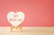mother's day concept image. Board by heart shape