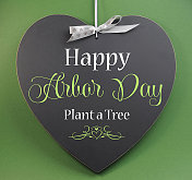 Happy Arbor Day, Plant a Tree greeting on blackboard