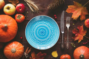 Autumnal table setting for Halloween or Thanksgiving day