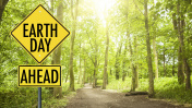 earth day street sign in the forest