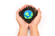 Soil and earth simulation in hand on white background, earth day concept