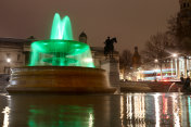 Green fountain for earth day with slow shutter speed at Trafalgar Square