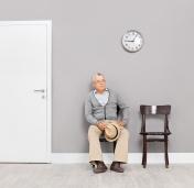 Bored senior gentleman sitting in an office lobby