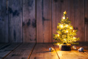 Christmas tree and ornaments on old wood