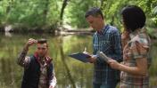 Three scientists exploring water in lake