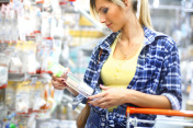 Woman buying baby goods in supermarket.