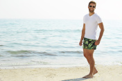 Shorts guy on beach