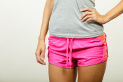 Female hips in sporty shorts