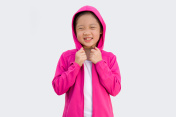 Asian Child in Sweater Isolated on White
