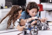 Positive pupils enjoying tech project at school