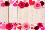 Valentines Day double border of hearts and roses against rustic white wood