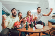 Group of friends watching a basketball game on tv