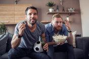 Two guys watching football game