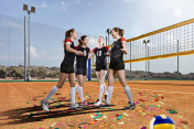 Female volleyball team on volleyball court