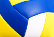 White, yellow and blue volleyball