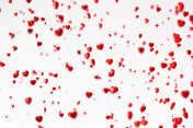 Red Hearts Falling Over White Background