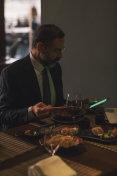 Mature Businessman Working in High-End Restaurant