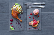 Roasted duck leg and foie gras, restaurant food closeup