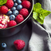 Healthy organic porridge topped with berries