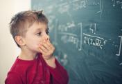 Little boy in math class overwhelmed by the math formula