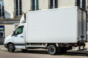 Blank white van or truck with copy space parked in a street
