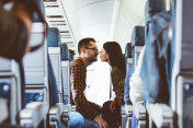 Couple in love traveling by airplane