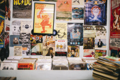 Pop music posters and records in a vinyl record shop