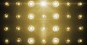 flashing shiny golden stage lights entertainment, spotlight projectors in the dark, gold warm soft light spotlight strike on black
