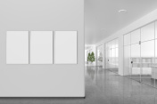 Blank poster on the wall in modern office interior