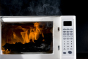 A picture of a microwave contains an object on fire