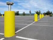 Yellow pillars with electrical plugs to connect the cars to heat up the engine and oil in extreme winter conditions in Alaska or Canada, car park in Fairbanks, Alaska