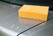 Car Wash with yellow sponge and foam