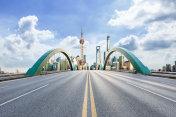 Asphalt highway and modern city commercial buildings in Shanghai