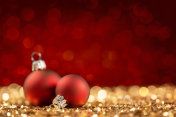 Two Christmas Balls on glittering surface