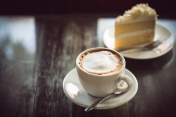 cup of coffee and cake on wooden table