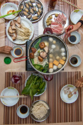 Asian family eating hot pot